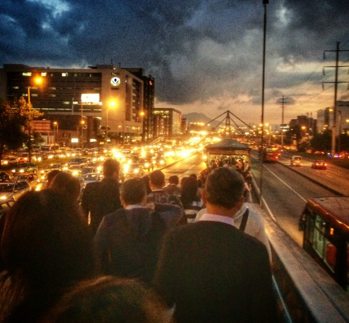 This is the crowd getting on the Transmilenio bus system at rush hour.